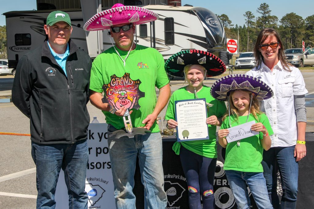 Smokin' Gringos of Charleston, SC was presented the Grand Champion title by SC Agriculture Assistant Director of Marketing Chad Truesdale at the 2019 Commissioner's Cup BBQ Cook-off.